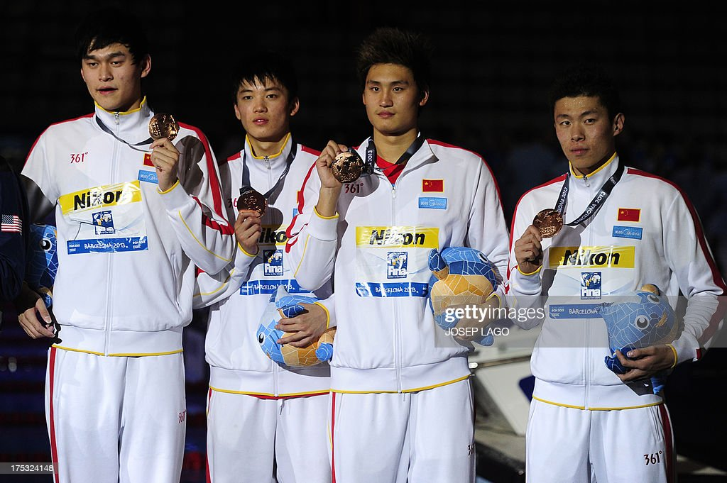 Bronze medalists China's Sun Yang, Hao Yun, Li Yunqi and Wang Shun pose during the award ceremony of the men's 4x200-metre freestyle relay swimming event in the FINA World Championships at Palau Sant Jordi in Barcelona on August 2, 2013. AFP PHOTO / JOSEP LAGO