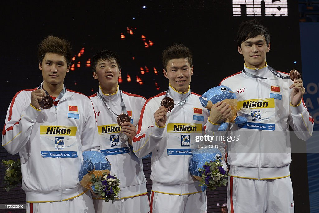 Bronze medalists China's Sun Yang, Hao Yun, Li Yunqi and Wang Shun pose on the podium during the award ceremony of the men's 4x200-metre freestyle relay swimming event in the FINA World Championships at Palau Sant Jordi in Barcelona on August 2, 2013.