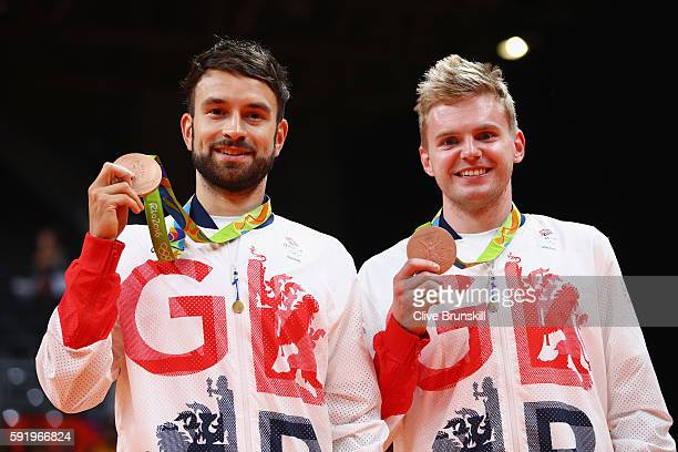 Bronze medalists Chris Langridge and Marcus Ellis of Great Britain stand on the podium during the medal ceremony after the Men's Badminton Doubles...