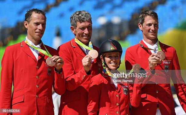 Bronze medalists Christian Ahlmann of Germany riding Taloubet Z Ludger Beerbaum of Germany riding Casello Meredith MichaelsBeerbaum of Germany riding...