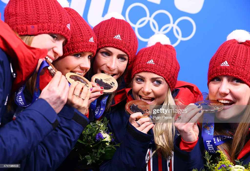 Bronze medalists Claire Hamilton Vicki Adams Eve Muirhead Anna Sloan and Lauren Gray of Great Britain celebrate during the medal ceremony for Women's...