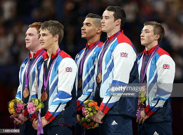 Bronze medalists Daniel Purvis Max Whitlock Louis Smith Kristian Thomas and Sam Oldham of Great Britain pose on the podium during the medal ceremony...
