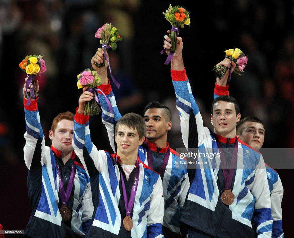 Bronze medalists Daniel Purvis, Max Whitlock, <a gi-track='captionPersonalityLinkClicked' href=/galleries/search?phrase=Louis+Smith+-+Gymnast&family=editorial&specificpeople=798756 ng-click='$event.stopPropagation()'>Louis Smith</a>, Kristian Thomas and Sam Oldham of Great Britain celebrate on the podium during the medal ceremony in the Artistic Gymnastics Men's Team final on Day 3 of the London 2012 Olympic Games at North Greenwich Arena on July 30, 2012 in London, England.