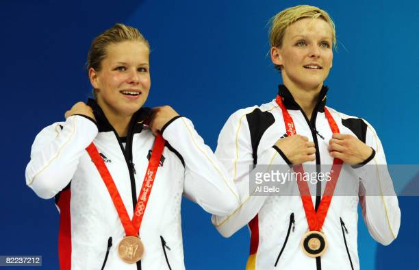 Bronze medalists Ditte Kotzian and Heike Fischer of Germany pose on the podium during the medal ceremony for the Women's Synchronized 3m Springboard...
