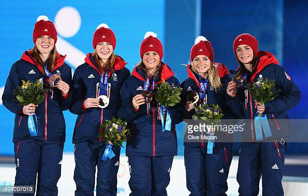 Bronze medalists Eve Muirhead Anna Sloan Vicki Adams and Claire Hamilton of Great Britain celebrate during the medal ceremony for Women's Curling on...
