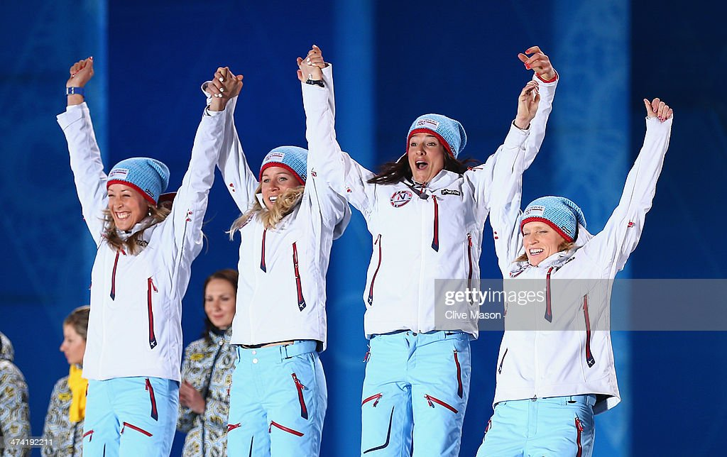 Bronze medalists Fanny Welle-Strand Horn, <a gi-track='captionPersonalityLinkClicked' href=/galleries/search?phrase=Tiril+Eckhoff&family=editorial&specificpeople=10023336 ng-click='$event.stopPropagation()'>Tiril Eckhoff</a>, Ann Kristin Aafedt Flatland and <a gi-track='captionPersonalityLinkClicked' href=/galleries/search?phrase=Tora+Berger&family=editorial&specificpeople=812729 ng-click='$event.stopPropagation()'>Tora Berger</a> of Norway celebrate during the medal ceremony for the Biathlon Women's 4 x 6 km Relay on Day 15 of the Sochi 2014 Winter Olympics at Medals Plaza on February 22, 2014 in Sochi, Russia.