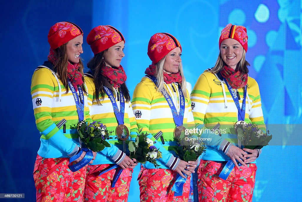 Bronze medalists Germany celebrate on the podium during the medal ceremony for the Women's 4 x 5 km Relay on day 9 of the Sochi 2014 Winter Olympics at Medals Plaza on February 16, 2014 in Sochi, Russia.