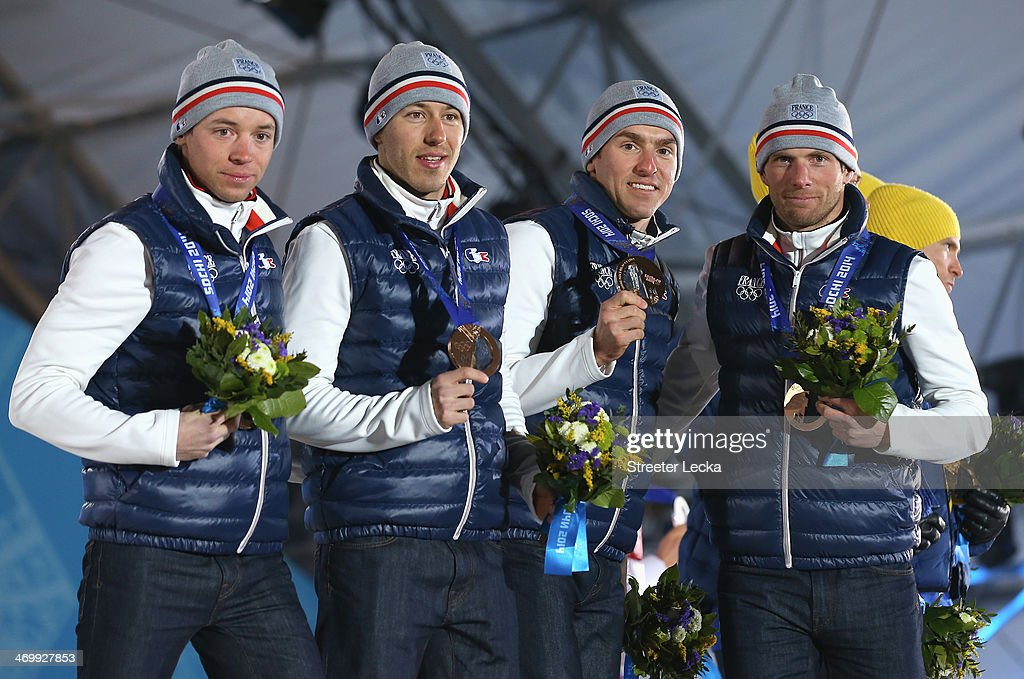 Bronze medalists <a gi-track='captionPersonalityLinkClicked' href=/galleries/search?phrase=Ivan+Perrillat+Boiteux&family=editorial&specificpeople=10523873 ng-click='$event.stopPropagation()'>Ivan Perrillat Boiteux</a>, <a gi-track='captionPersonalityLinkClicked' href=/galleries/search?phrase=Robin+Duvillard&family=editorial&specificpeople=6680782 ng-click='$event.stopPropagation()'>Robin Duvillard</a>, <a gi-track='captionPersonalityLinkClicked' href=/galleries/search?phrase=Maurice+Manificat&family=editorial&specificpeople=5632025 ng-click='$event.stopPropagation()'>Maurice Manificat</a> and Jean Marc Gaillard of France celebrate on the podium during the medal ceremony for the Cross Country Men's 4 x 10 km Relay on day ten of the Sochi 2014 Winter Olympics at the Medals Plaza on February 17, 2014 in Sochi, Russia.