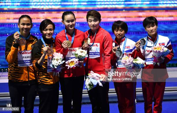 Bronze medalists Jun Hoong Cheong and Pandelela Pamg of Malaysia gold medalists Qian Ren and Yajie Si of China and Silver medalists Rae Kim Mi and...