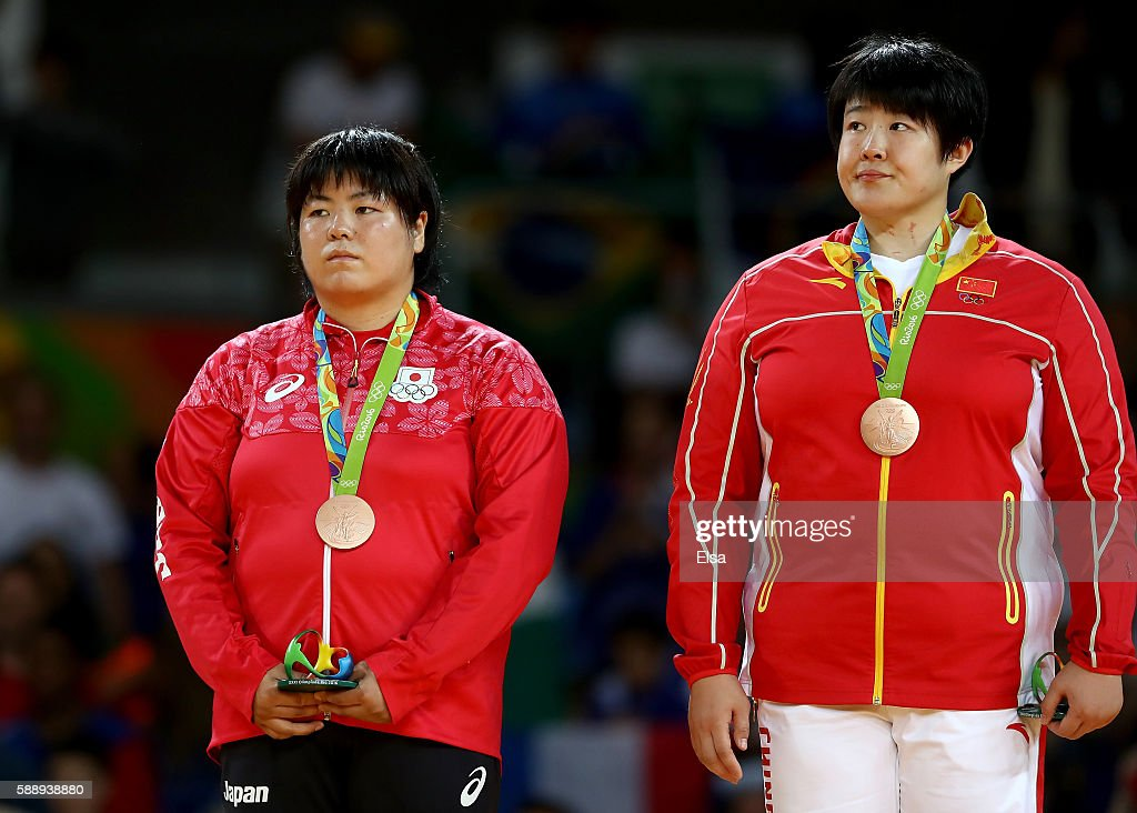 Bronze medalists Kanae Yamabe of Japan and Song Yu of China celebrates on the podium after the Women's 78kg Judo contest on Day 7 of the Rio 2016...