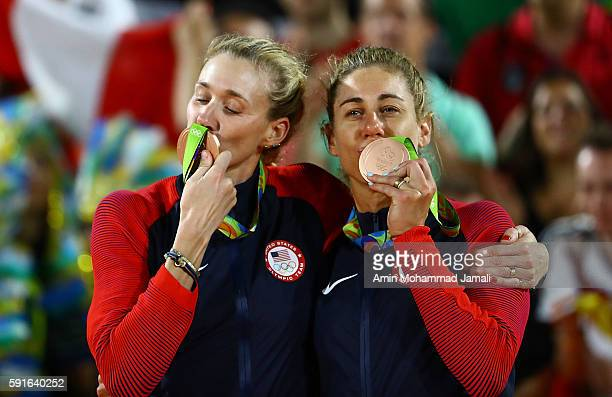 Bronze medalists Kerri Walsh Jennings and April Ross of the United States pose on the podium during the medal ceremony for the Women's Beach...