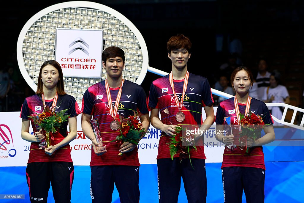 Bronze medalists Ko Sung Hyun (3rd R) and Kim Ha Na (L) of South Korea and Shin Baek Cheol (2nd R) and Chae Yoo Jung (R) of South Korea pose with their bronze medals during the award ceremony of the mixed doubles at the 2016 Badminton Asia Championships in Wuhan, central China's Hubei province on May 1, 2016. / AFP / STR / China OUT
