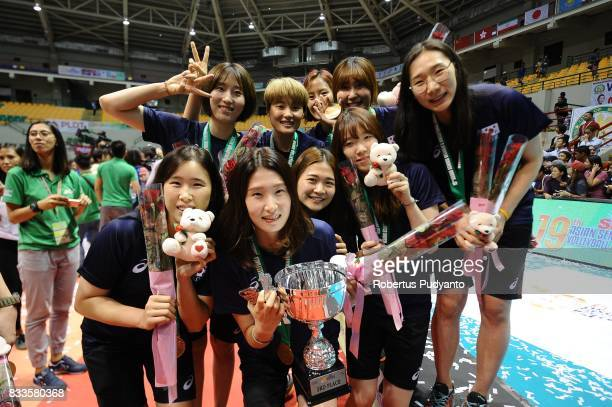 Bronze medalists Korea team celebrate on the podium during the 19th Asian Senior Women's Volleyball Championship 2017 awarding ceremony at Alonte...
