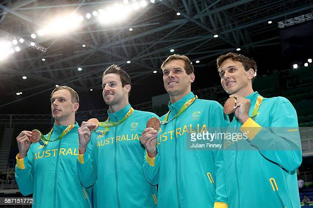Bronze medalists Kyle Chalmers James Magnussen James Roberts and Cameron McEvoy of Australia pose during the medal ceremony for the Final of the...