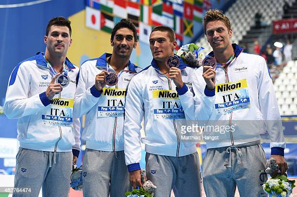 Bronze medalists Luca Dotto Filippo Magnini Michele Santucci and Marco Orsi of Italy pose during the medal ceremony for the Men's 4x100m Freestyle...