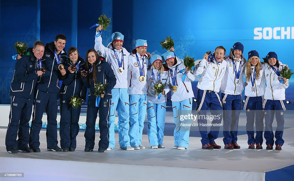 Bronze medalists <a gi-track='captionPersonalityLinkClicked' href=/galleries/search?phrase=Lukas+Hofer&family=editorial&specificpeople=6583823 ng-click='$event.stopPropagation()'>Lukas Hofer</a>, <a gi-track='captionPersonalityLinkClicked' href=/galleries/search?phrase=Dominik+Windisch&family=editorial&specificpeople=8683936 ng-click='$event.stopPropagation()'>Dominik Windisch</a>, <a gi-track='captionPersonalityLinkClicked' href=/galleries/search?phrase=Karin+Oberhofer&family=editorial&specificpeople=6690558 ng-click='$event.stopPropagation()'>Karin Oberhofer</a> and <a gi-track='captionPersonalityLinkClicked' href=/galleries/search?phrase=Dorothea+Wierer&family=editorial&specificpeople=7438920 ng-click='$event.stopPropagation()'>Dorothea Wierer</a> of Italy, gold medalists <a gi-track='captionPersonalityLinkClicked' href=/galleries/search?phrase=Emil+Hegle+Svendsen&family=editorial&specificpeople=831528 ng-click='$event.stopPropagation()'>Emil Hegle Svendsen</a>, <a gi-track='captionPersonalityLinkClicked' href=/galleries/search?phrase=Ole+Einar+Bjoerndalen&family=editorial&specificpeople=206663 ng-click='$event.stopPropagation()'>Ole Einar Bjoerndalen</a>, <a gi-track='captionPersonalityLinkClicked' href=/galleries/search?phrase=Tiril+Eckhoff&family=editorial&specificpeople=10023336 ng-click='$event.stopPropagation()'>Tiril Eckhoff</a> and <a gi-track='captionPersonalityLinkClicked' href=/galleries/search?phrase=Tora+Berger&family=editorial&specificpeople=812729 ng-click='$event.stopPropagation()'>Tora Berger</a> of Norway, silver medalists Ondrej Moravec, <a gi-track='captionPersonalityLinkClicked' href=/galleries/search?phrase=Jaroslav+Soukup&family=editorial&specificpeople=4058123 ng-click='$event.stopPropagation()'>Jaroslav Soukup</a>, Gabriela Soukalova and Veronika Vitkova of the Czech Republic celebrate during the medal ceremony for the 2 x 6 km Women + 2 x 7 km Men Mixed Relay on day thirteen of the Sochi 2014 Winter Olympics at at Medals Plaza on February 20, 2014 in Sochi, Russia.