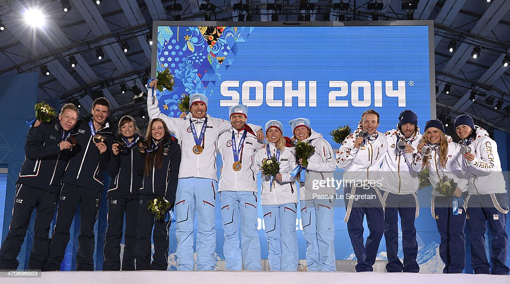 Bronze medalists <a gi-track='captionPersonalityLinkClicked' href=/galleries/search?phrase=Lukas+Hofer&family=editorial&specificpeople=6583823 ng-click='$event.stopPropagation()'>Lukas Hofer</a>, <a gi-track='captionPersonalityLinkClicked' href=/galleries/search?phrase=Dominik+Windisch&family=editorial&specificpeople=8683936 ng-click='$event.stopPropagation()'>Dominik Windisch</a>, <a gi-track='captionPersonalityLinkClicked' href=/galleries/search?phrase=Karin+Oberhofer&family=editorial&specificpeople=6690558 ng-click='$event.stopPropagation()'>Karin Oberhofer</a> and <a gi-track='captionPersonalityLinkClicked' href=/galleries/search?phrase=Dorothea+Wierer&family=editorial&specificpeople=7438920 ng-click='$event.stopPropagation()'>Dorothea Wierer</a> of Italy, gold medalists <a gi-track='captionPersonalityLinkClicked' href=/galleries/search?phrase=Emil+Hegle+Svendsen&family=editorial&specificpeople=831528 ng-click='$event.stopPropagation()'>Emil Hegle Svendsen</a>, Ole Einar Bjoerndalen, <a gi-track='captionPersonalityLinkClicked' href=/galleries/search?phrase=Tiril+Eckhoff&family=editorial&specificpeople=10023336 ng-click='$event.stopPropagation()'>Tiril Eckhoff</a> and <a gi-track='captionPersonalityLinkClicked' href=/galleries/search?phrase=Tora+Berger&family=editorial&specificpeople=812729 ng-click='$event.stopPropagation()'>Tora Berger</a> of Norway, silver medalists Ondrej Moravec, <a gi-track='captionPersonalityLinkClicked' href=/galleries/search?phrase=Jaroslav+Soukup&family=editorial&specificpeople=4058123 ng-click='$event.stopPropagation()'>Jaroslav Soukup</a>, Gabriela Soukalova and Veronika Vitkova of the Czech Republic celebrate during the medal ceremony for the 2 x 6 km Women + 2 x 7 km Men Mixed Relay on day thirteen of the Sochi 2014 Winter Olympics at at Medals Plaza on February 20, 2014 in Sochi, Russia.