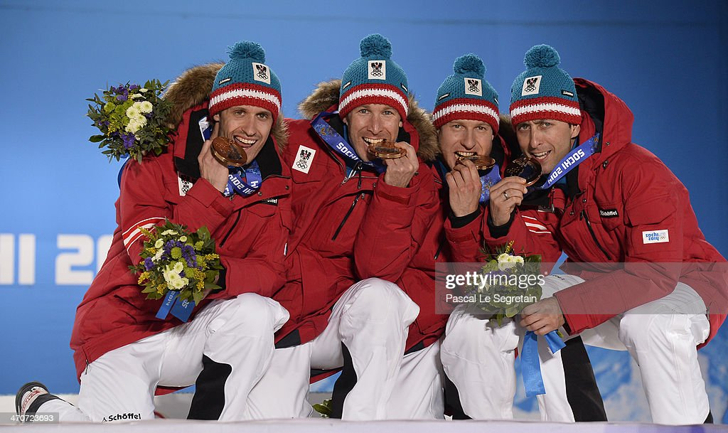 Bronze medalists <a gi-track='captionPersonalityLinkClicked' href=/galleries/search?phrase=Lukas+Klapfer&family=editorial&specificpeople=5744499 ng-click='$event.stopPropagation()'>Lukas Klapfer</a>, <a gi-track='captionPersonalityLinkClicked' href=/galleries/search?phrase=Bernhard+Gruber&family=editorial&specificpeople=824521 ng-click='$event.stopPropagation()'>Bernhard Gruber</a>, <a gi-track='captionPersonalityLinkClicked' href=/galleries/search?phrase=Mario+Stecher&family=editorial&specificpeople=724611 ng-click='$event.stopPropagation()'>Mario Stecher</a> and <a gi-track='captionPersonalityLinkClicked' href=/galleries/search?phrase=Christoph+Bieler&family=editorial&specificpeople=724610 ng-click='$event.stopPropagation()'>Christoph Bieler</a> of Austria celebrate during the medal ceremony for the Nordic Combined Team Large Hill / 4 x 5 km on day thirteen of the Sochi 2014 Winter Olympics at at Medals Plaza on February 20, 2014 in Sochi, Russia.
