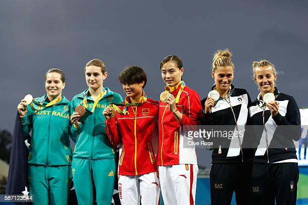 Bronze medalists Maddison Keeney and Anabelle Smith of Australia gold medalists Tingmao Shi and Minxia Wu of China and Silver medalists Tania...
