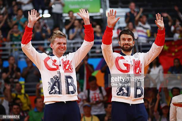 Bronze medalists Marcus Ellis and Chris Langridge of Great Britain stand on the podium during the medal ceremony after the Men's Badminton Doubles...