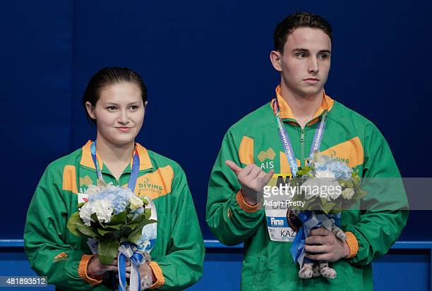 Bronze medalists Melissa Wu and Domonic Bedggood of Australia pose on the podium following the 10m Platform Synchronised Mixed Diving Final on day...