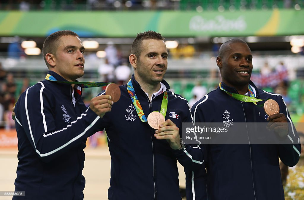Bronze medalists Michael D'Almeida Francois Pervis and Gregory Bauge of France stand on the podium after the Men's Team Sprint Track Cycling Finals...