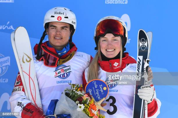 Bronze medalists Mikael Kingsbury of Canada and Justine DufourLapointe of Canada pose during the flower ceremony for the Men's and Women's Moguls on...