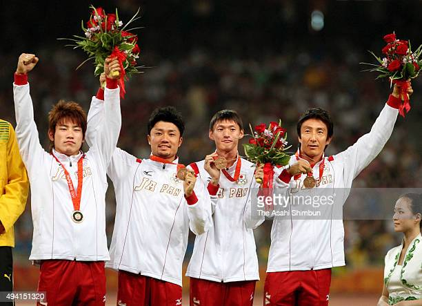 Bronze medalists Naoki Tsukahara Shingo Suetsugu Shinji Takahira and Nobuharu Asahara of Japan celebrate on the podium at the medal ceremony for the...