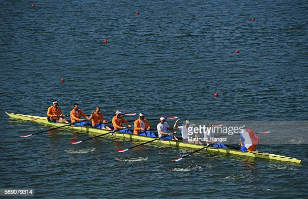 Bronze medalists Netherlands celebrate on their boat after the medal ceremony for the Men's Eight on Day 8 of the Rio 2016 Olympic Games at the Lagoa...