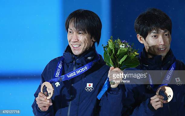 Bronze medalists Noriaki Kasai and Daiki Ito of Japan celebrate during the medal ceremony for the Men's Team Ski Jumping on day 11 of the Sochi 2014...