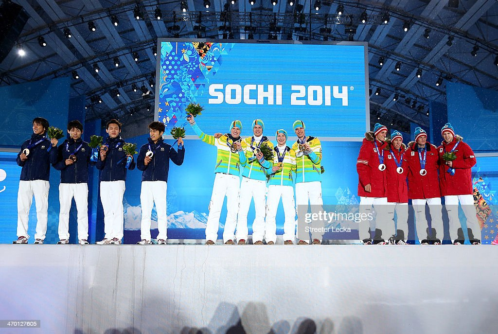 Bronze medalists <a gi-track='captionPersonalityLinkClicked' href=/galleries/search?phrase=Noriaki+Kasai&family=editorial&specificpeople=722779 ng-click='$event.stopPropagation()'>Noriaki Kasai</a>, <a gi-track='captionPersonalityLinkClicked' href=/galleries/search?phrase=Daiki+Ito&family=editorial&specificpeople=722800 ng-click='$event.stopPropagation()'>Daiki Ito</a>, <a gi-track='captionPersonalityLinkClicked' href=/galleries/search?phrase=Taku+Takeuchi&family=editorial&specificpeople=4206331 ng-click='$event.stopPropagation()'>Taku Takeuchi</a> and <a gi-track='captionPersonalityLinkClicked' href=/galleries/search?phrase=Reruhi+Shimizu&family=editorial&specificpeople=9641103 ng-click='$event.stopPropagation()'>Reruhi Shimizu</a>i of Japan, gold medalists <a gi-track='captionPersonalityLinkClicked' href=/galleries/search?phrase=Severin+Freund&family=editorial&specificpeople=4780594 ng-click='$event.stopPropagation()'>Severin Freund</a>, <a gi-track='captionPersonalityLinkClicked' href=/galleries/search?phrase=Andreas+Wellinger&family=editorial&specificpeople=8795492 ng-click='$event.stopPropagation()'>Andreas Wellinger</a>, <a gi-track='captionPersonalityLinkClicked' href=/galleries/search?phrase=Marinus+Kraus&family=editorial&specificpeople=11675455 ng-click='$event.stopPropagation()'>Marinus Kraus</a> and <a gi-track='captionPersonalityLinkClicked' href=/galleries/search?phrase=Andreas+Wank&family=editorial&specificpeople=2507492 ng-click='$event.stopPropagation()'>Andreas Wank</a> of Germany and silver medalists <a gi-track='captionPersonalityLinkClicked' href=/galleries/search?phrase=Gregor+Schlierenzauer&family=editorial&specificpeople=2963942 ng-click='$event.stopPropagation()'>Gregor Schlierenzauer</a>, <a gi-track='captionPersonalityLinkClicked' href=/galleries/search?phrase=Thomas+Diethart&family=editorial&specificpeople=12267460 ng-click='$event.stopPropagation()'>Thomas Diethart</a>, <a gi-track='captionPersonalityLinkClicked' href=/galleries/search?phrase=Thomas+Morgenstern&family=editorial&specificpeople=221616 ng-click='$event.stopPropagation()'>Thomas Morgenstern</a> and <a gi-track='captionPersonalityLinkClicked' href=/galleries/search?phrase=Michael+Hayboeck&family=editorial&specificpeople=10065667 ng-click='$event.stopPropagation()'>Michael Hayboeck</a> of Austria celebrate during the medal ceremony for the Men's Team Ski Jumping on day 11 of the Sochi 2014 Winter Olympics at Medals Plaza on February 18, 2014 in Sochi, Russia.