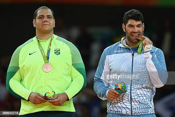 Bronze medalists Rafael Silva of Brazil and Or Sasson of Israel during the Men's 100kg Judo contest on Day 7 of the Rio 2016 Olympic Games at Carioca...