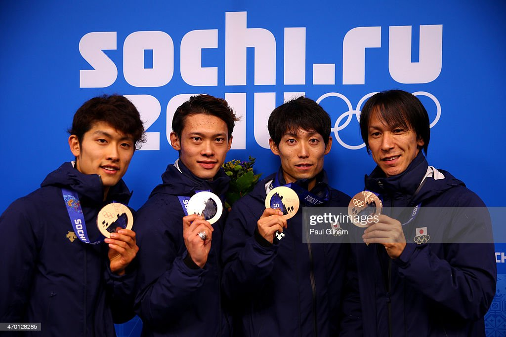 Bronze medalists Reruhi Shimizu, Taku Takeuchi, Daiki Ito and Noriaki Kasai of Japan celebrate during the medal ceremony for the Men's Team Ski Jumping on day 11 of the Sochi 2014 Winter Olympics at Medals Plaza on February 18, 2014 in Sochi, Russia.