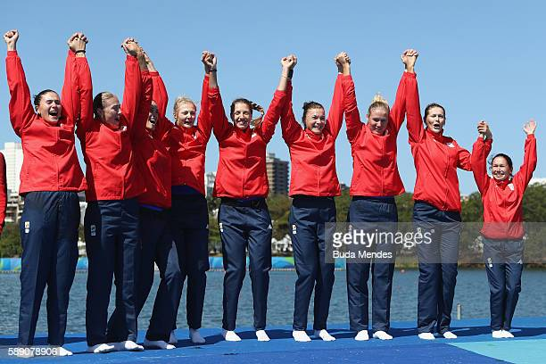 Bronze medalists Romania celebrate on the podium at the medal ceremony for the Women's Eight on Day 8 of the Rio 2016 Olympic Games at the Lagoa...