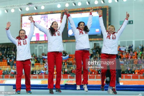 Bronze medalists Russia celebrate during the medal ceremony for the Speed Skating Women's Pursuit on day fifteen of the Sochi 2014 Winter Olympics at...