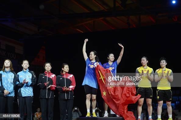 Bronze medalists South Korea's Seung Chan Shin and So Hee Lee and Japan's Miyuki Maeda and Reika Kakiiwa and Gold medalists China's Zhao Yunlei and...