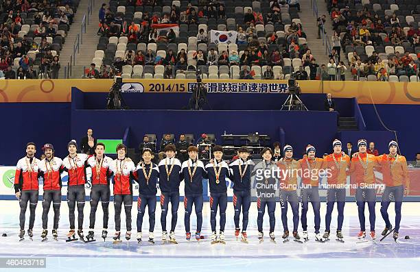 Bronze medalists team Canada Gold medalists team South Korea and Silver medalists team Netherlands pose in the Men 5000M relay Final during the ISU...