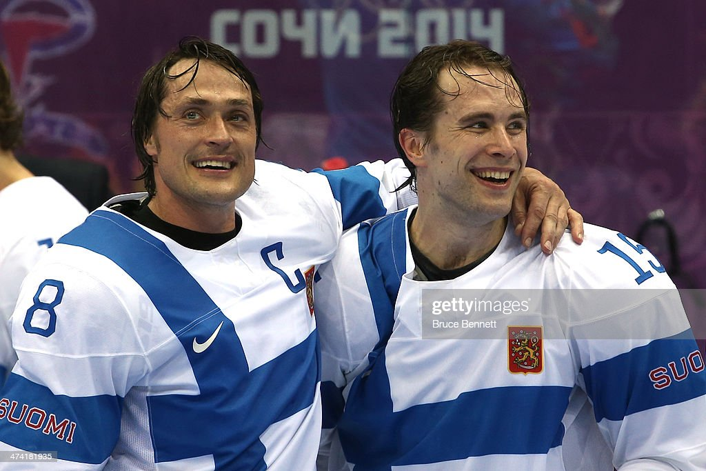 Bronze medalists Teemu Selanne #8 and Tuomo Ruutu #15 of Finland celebrate during the flower ceremony after defeating the United States 5-0 during the Men's Ice Hockey Bronze Medal Game on Day 15 of the 2014 Sochi Winter Olympics at Bolshoy Ice Dome on February 22, 2014 in Sochi, Russia.