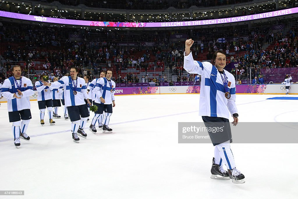 Bronze medalists Teemu Selanne #8 of Finland and teammates celebrate after defeating the United States 5-0 during the Men's Ice Hockey Bronze Medal Game on Day 15 of the 2014 Sochi Winter Olympics at Bolshoy Ice Dome on February 22, 2014 in Sochi, Russia.