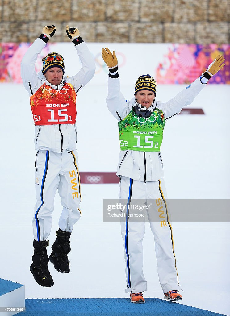 Bronze medalists <a gi-track='captionPersonalityLinkClicked' href=/galleries/search?phrase=Teodor+Peterson&family=editorial&specificpeople=6567370 ng-click='$event.stopPropagation()'>Teodor Peterson</a> of Sweden and <a gi-track='captionPersonalityLinkClicked' href=/galleries/search?phrase=Emil+Joensson&family=editorial&specificpeople=4045550 ng-click='$event.stopPropagation()'>Emil Joensson</a> of Sweden celebrate on the podium during the flower ceremony for the Men's Team Sprint Classic Final during day 12 of the 2014 Sochi Winter Olympics at Laura Cross-country Ski & Biathlon Center on February 19, 2014 in Sochi, Russia.