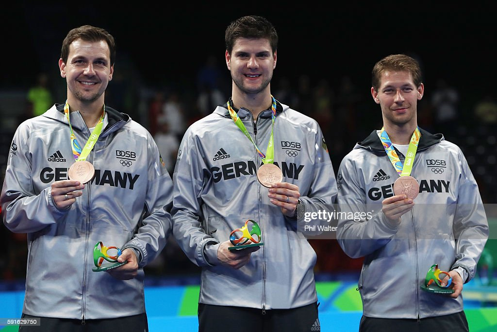 Bronze medalists Timo Boll, Dimitrij Ovtcharov, and Bastian Steger of Germany celebrate on the podium during the Men's Team Table Tennis medal ceremony on Day 12 of the Rio 2016 Olympic Games at Riocentro - Pavilion 3 on August 17, 2016 in Rio de Janeiro, Brazil.