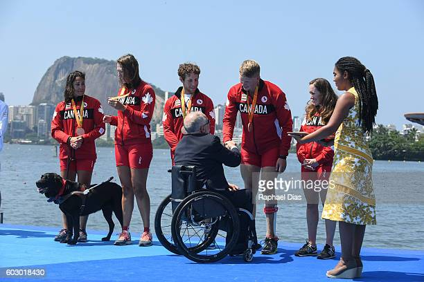 Bronze medalists Victoria Nolan Meghan Montgomery Andrew Todd Curtis Halladay and Kristen Kit from Canada on the podium receiving medals from the...