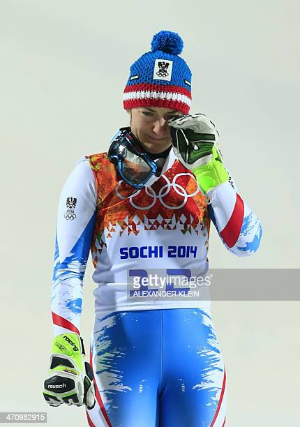 Bronze medallist AusAustria's Kathrin Zettel sheds a tear on the podium during the Women's Alpine Skiing Slalom Flower Ceremony at the Rosa Khutor...