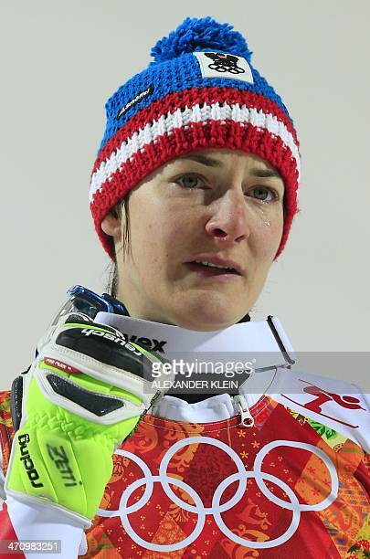 Bronze medallist Austria's Kathrin Zettel sheds a tear during the Women's Alpine Skiing Slalom Flower Ceremony at the Rosa Khutor Alpine Center...