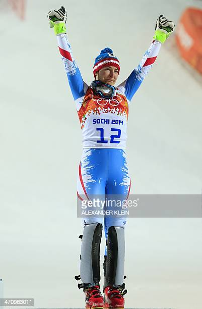 Bronze medallist Austria's Kathrin Zettel sheds a tear on the podium during the Women's Alpine Skiing Slalom Flower Ceremony at the Rosa Khutor...