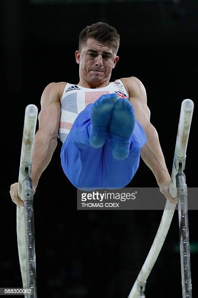 Bronze medallist Britain's Max Whitlock competes in the parallel bars event of the men's individual allaround final of the Artistic Gymnastics at the...