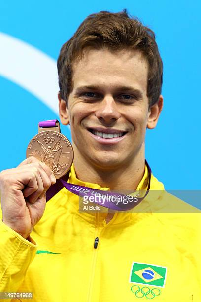 Bronze medallist Cesar Cielo of Brazil poses on the podium during the medal ceremony for the Men's 50m Freestyle Final on Day 7 of the London 2012...