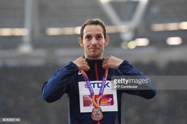 Bronze medallist France's Renaud Lavillenie poses on the podium during the victory ceremony for the men's pole vault athletics event at the 2017 IAAF...