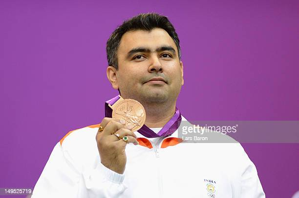 Bronze medallist Gagan Narang of India poses with the bronze medal won in the Men's 10m Air Rifle Shooting final final on Day 3 of the London 2012...