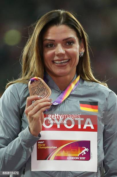 Bronze medallist Germany's Pamela Dutkiewicz poses on the podium during the victory ceremony for the women's 100m hurdles athletics event at the 2017...